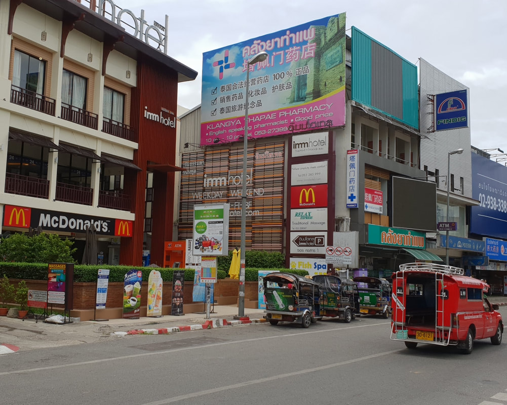 Imm Hotel and Mc Donalds at Tha Phae Gate Chiang Mai, Thailand.  塔佩门